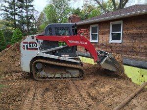 track loader pushing dirt