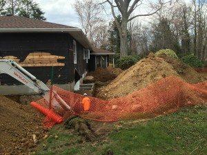 digging up basement wall